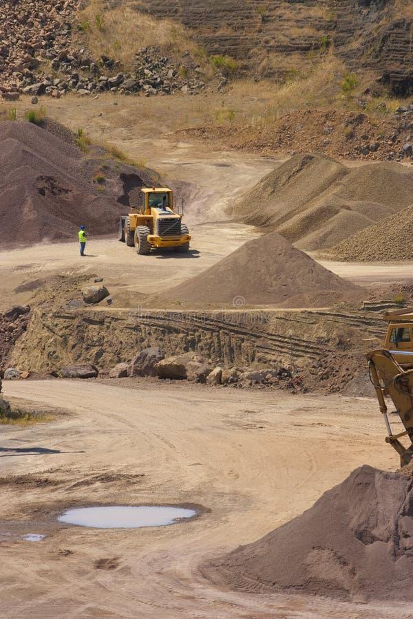 Escavadora na ação fotografia de stock
