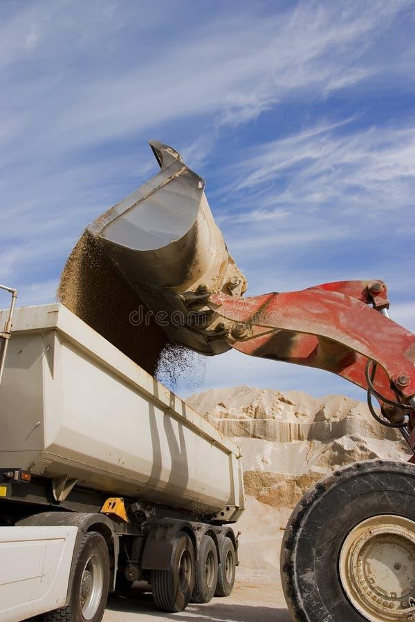Escavadora no trabalho imagem de stock