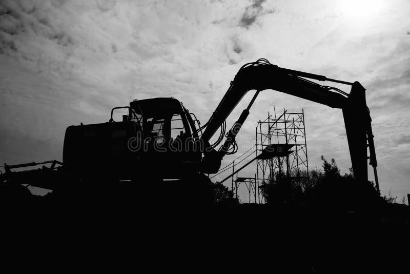 Escavator fonctionnant photo libre de droits