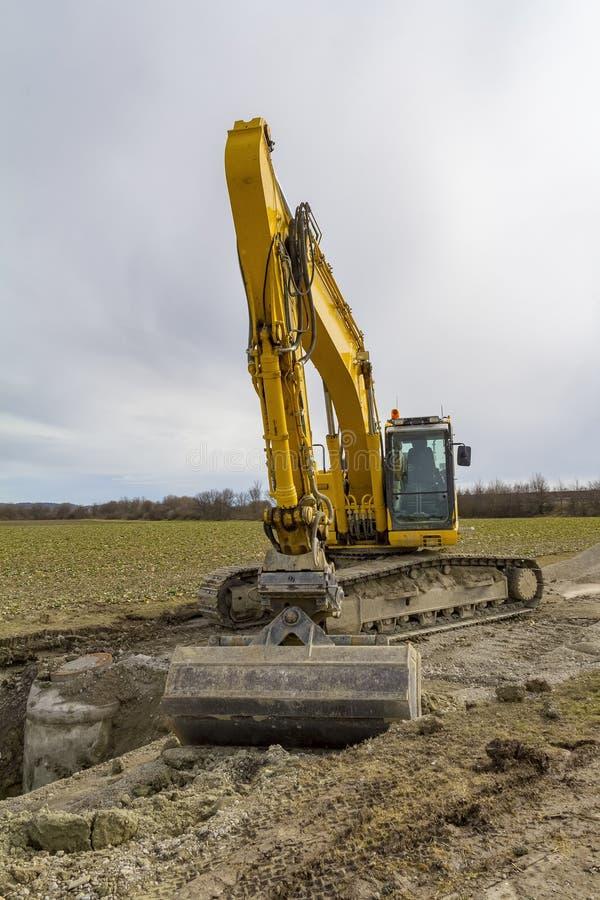 Escavatore ad un cantiere immagine stock libera da diritti