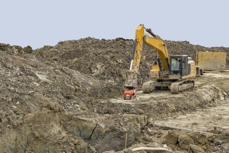 Escavatore ad un cantiere fotografie stock