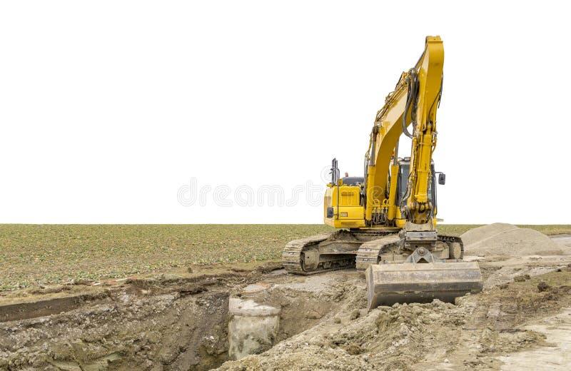 Escavatore ad un cantiere immagini stock
