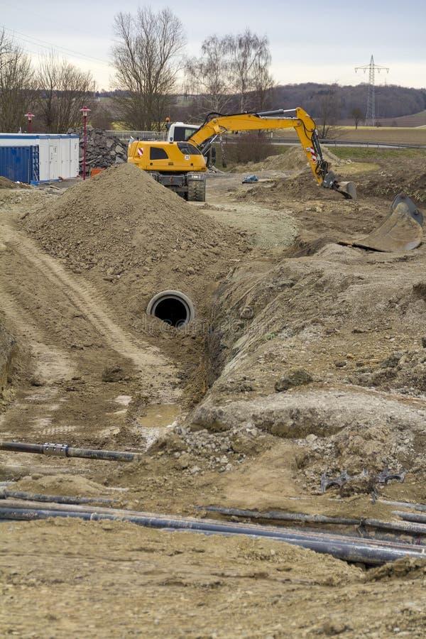 Escavatore ad un cantiere immagine stock