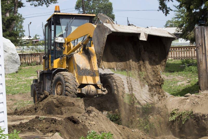 Escavatore al cantiere fotografia stock libera da diritti