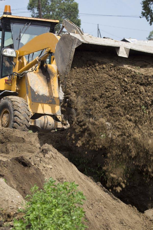 Escavatore al cantiere fotografie stock