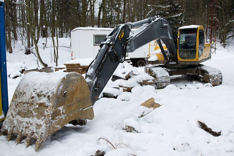 Escavatore in inverno fotografia stock libera da diritti