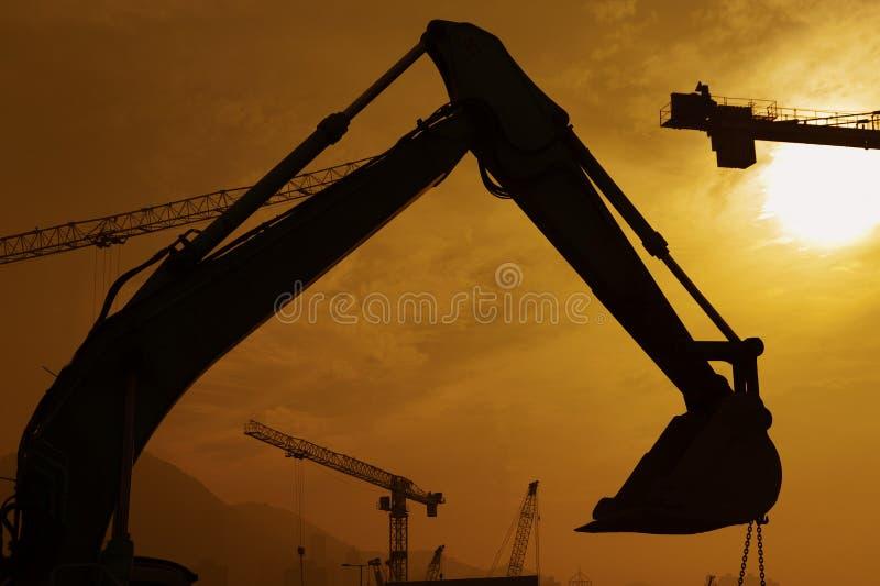 Escavatore in nuova via della costruzione site fotografie stock libere da diritti
