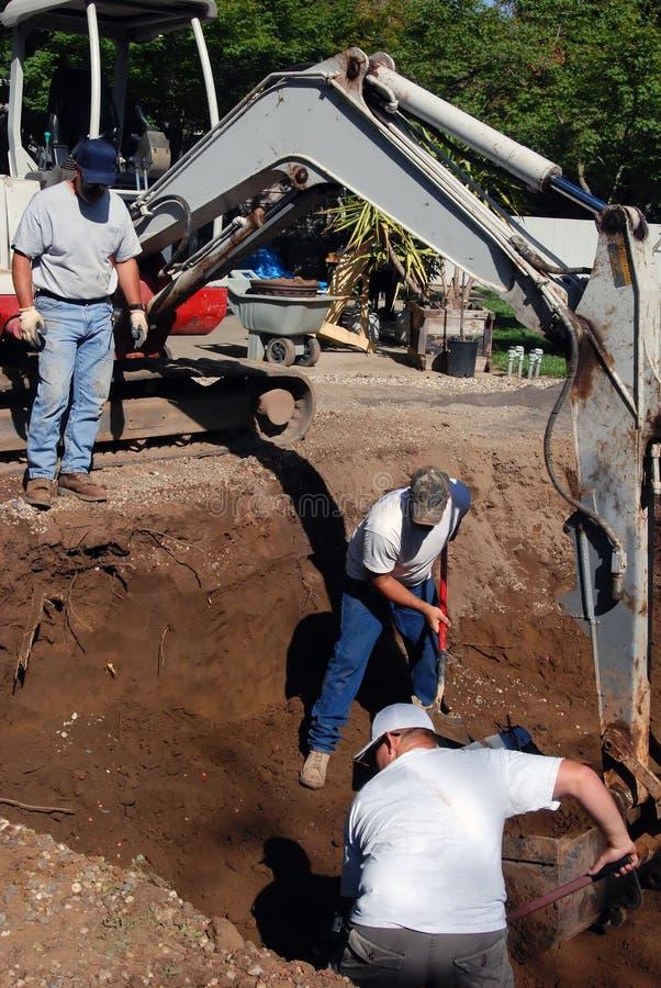 Escavatori del raggruppamento immagine stock