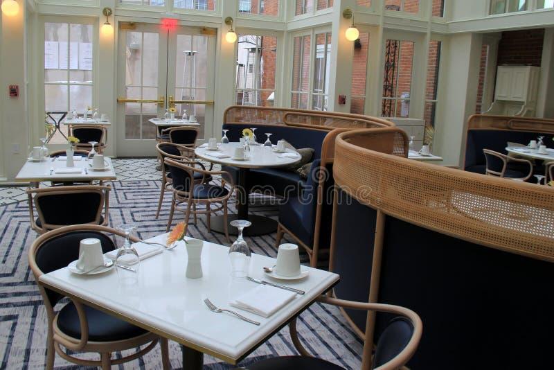 Escena hermosa del ajuste que da la bienvenida caliente, Hen Restaurant azul, el hotel de Adelphi, Saratoga Springs, Nueva York,  imagen de archivo