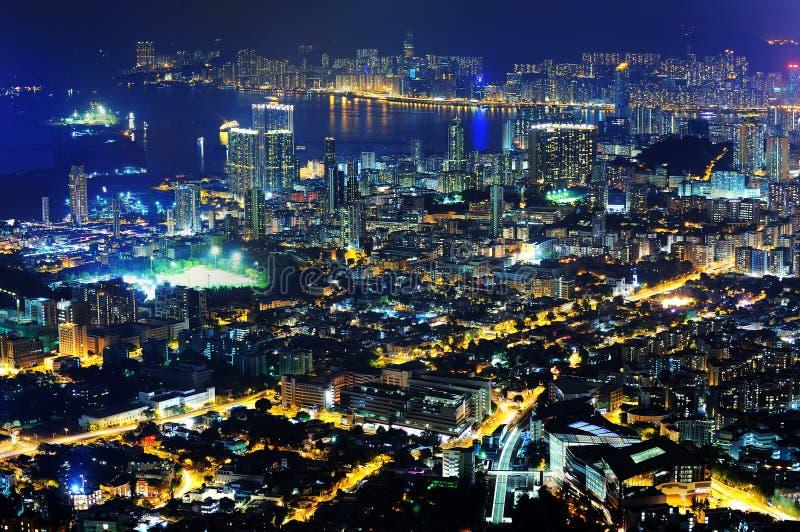 Escenas de la noche de la isla de Kowloon y de Hong-Kong fotografía de archivo