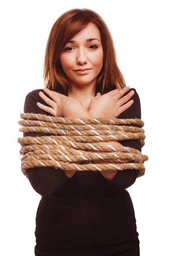 Esclavitud atada preso de la hembra del rehén de la cuerda de la mujer fotografía de archivo