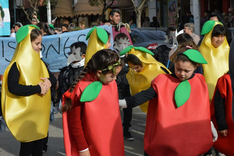 Escobar, Argentina, eight july two thousand and sixteen. Children with fruit clothes and fruit yellow red in commemoration. Of the independence of the Argentina stock photography