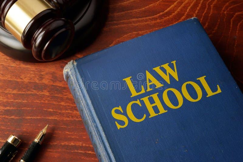 Escola de direito do título em um livro imagens de stock royalty free