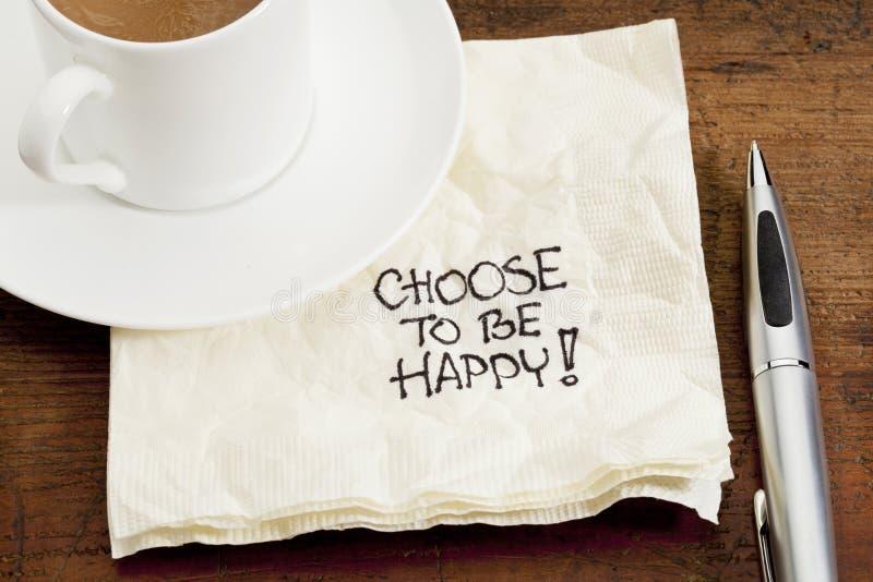 Escolha estar feliz em um guardanapo fotos de stock