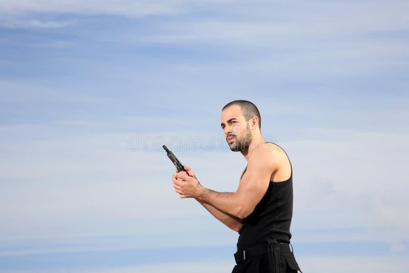 Download Homem com uma arma imagem de stock. Imagem de holding - 29832517