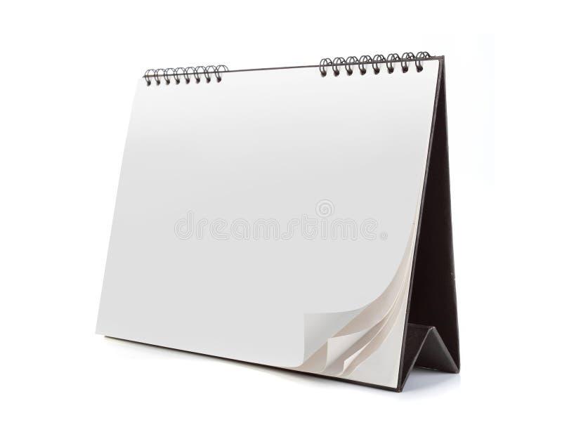 Esconda el calendario aislado en el fondo blanco fotografía de archivo