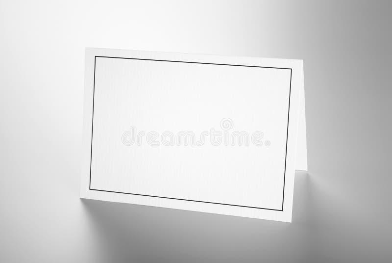 Esconda la tarjeta doblada con el marco negro fotos de archivo