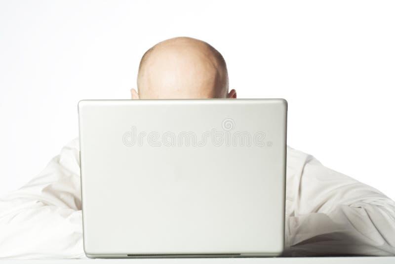 Esconder atrás de um computador fotos de stock