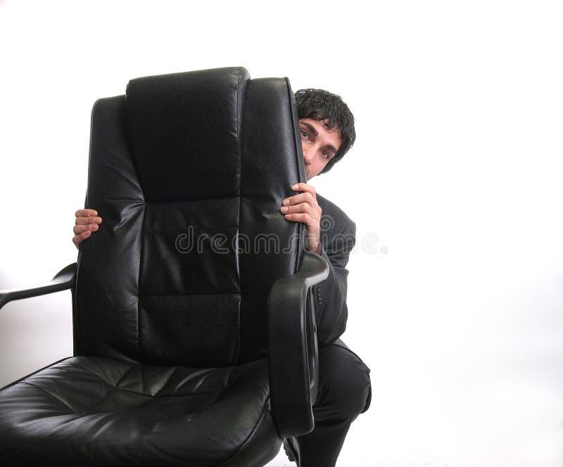 Esconder do homem de negócios fotografia de stock