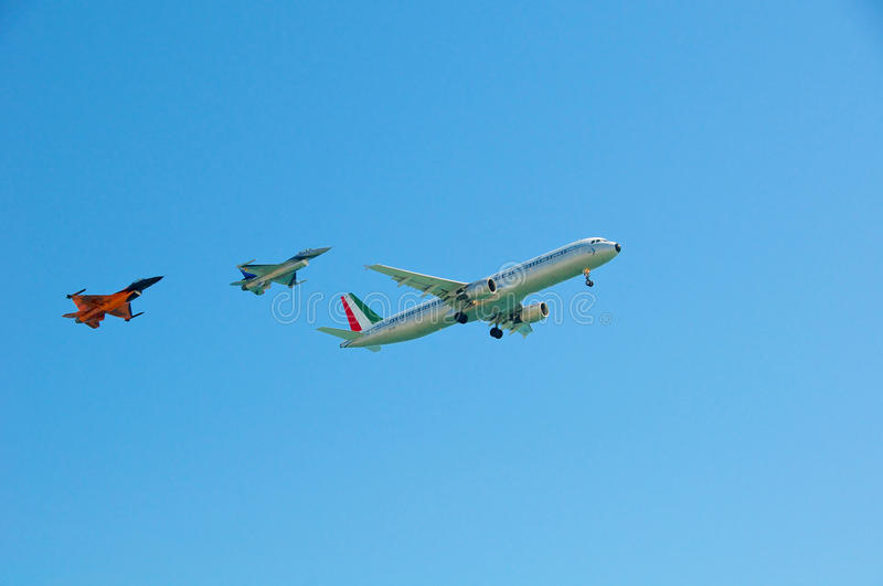 Escort Airbus A321 and F-16. Two F-16 Escorted an Airbus A321 stock photos