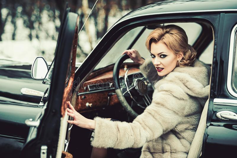 Escort and security guard for luxury woman. sexy woman in fur coat. Travel and business trip or hitch hiking. Call girl stock photography