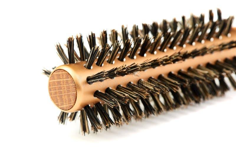 Escova de cabelo de madeira moderna nova no fundo branco fotografia de stock royalty free