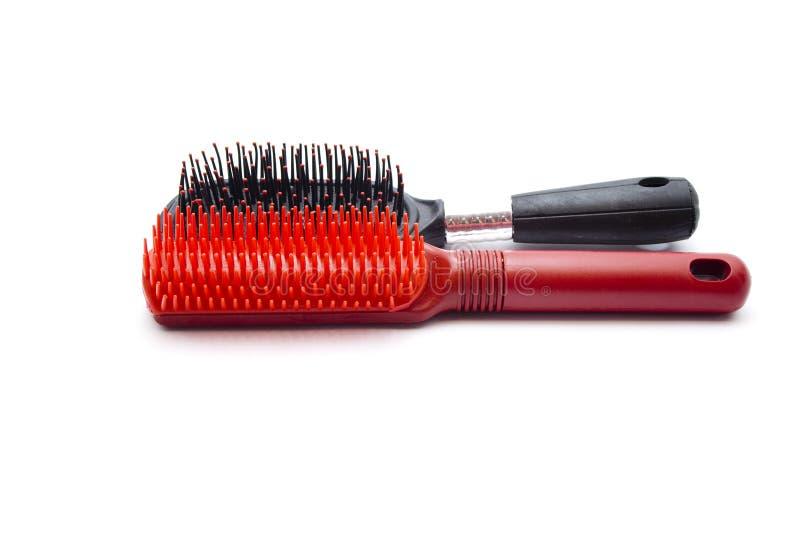 Escova de cabelo plástica diferente fotos de stock