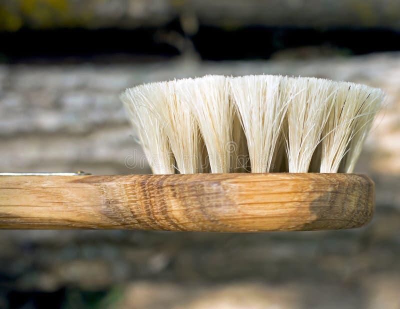 Escova de madeira com um punho fotos de stock