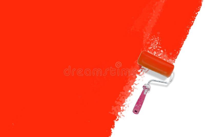 Escova do rolo com o modelo vermelho da trilha da pintura Conceito criativo, da decoração e da renovação fotografia de stock