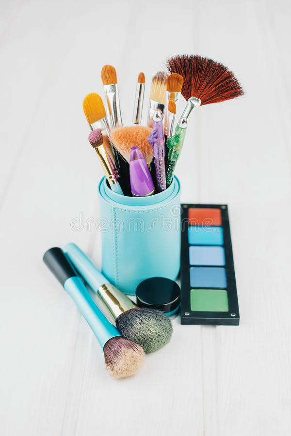 Escova e cosméticos da composição fotos de stock royalty free
