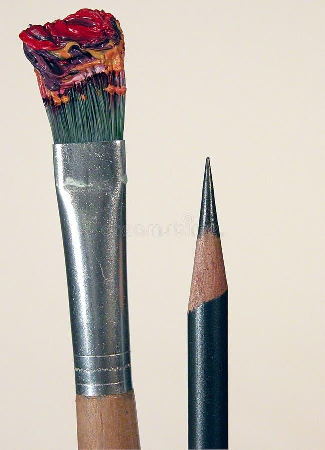 Escova e lápis imagens de stock