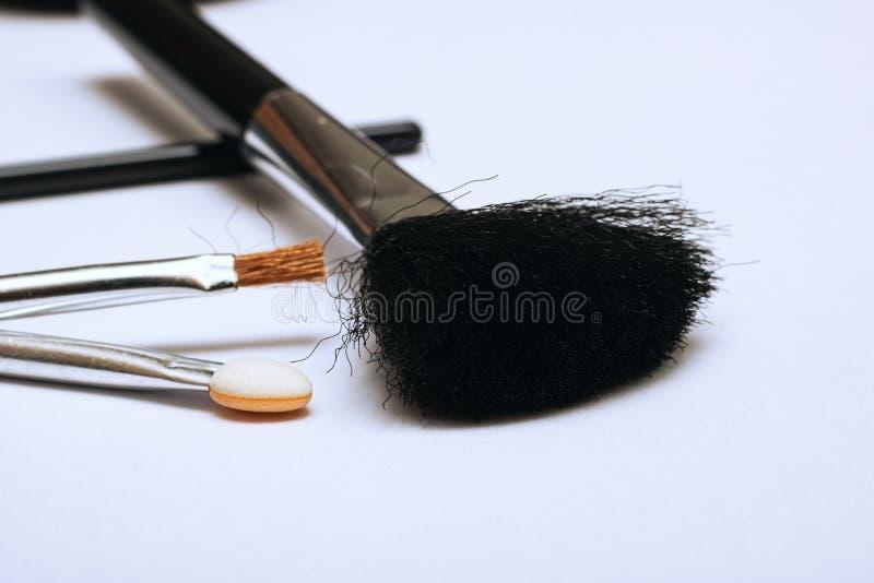A escova para aplicar-se cora, acessórios da composição fotografia de stock