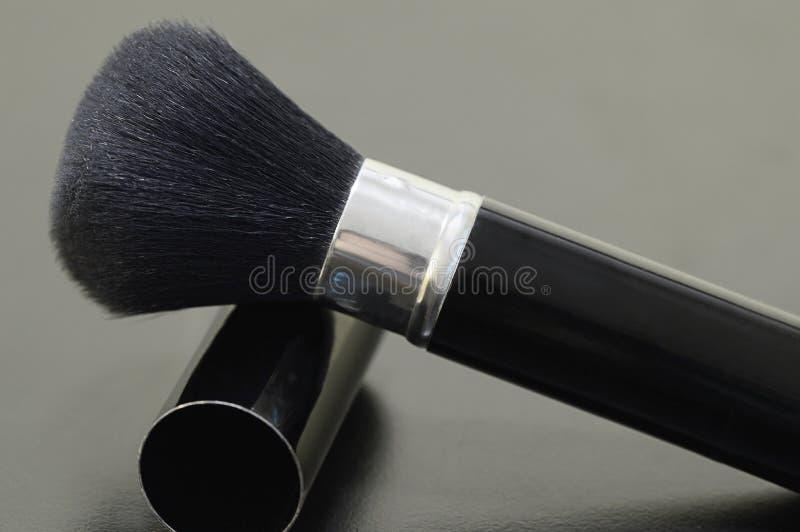 A escova retrátil para aplicar-se cora e pulveriza fotos de stock royalty free