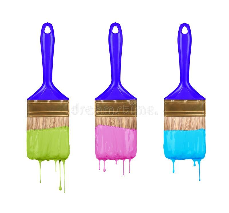 Escovas da pintura colorida gotejamento fotografia de stock