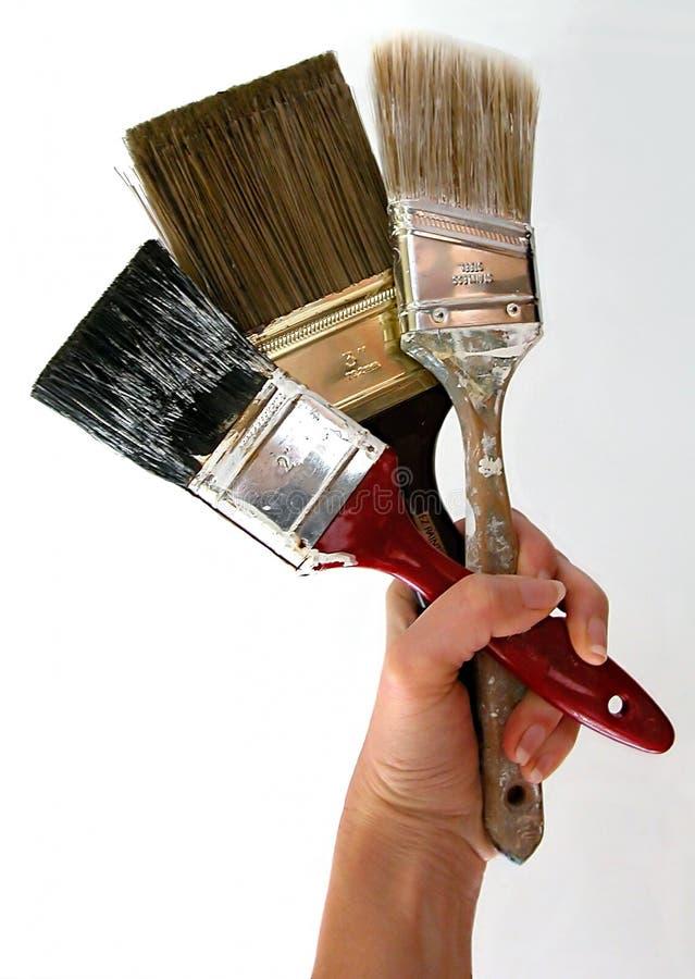 Escovas de pintura 3 fotos de stock royalty free
