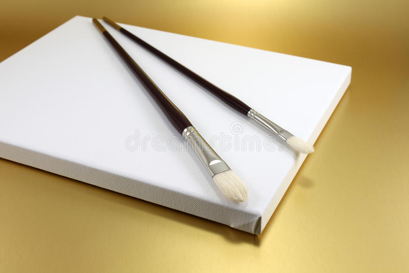 Escovas do artista fotografia de stock