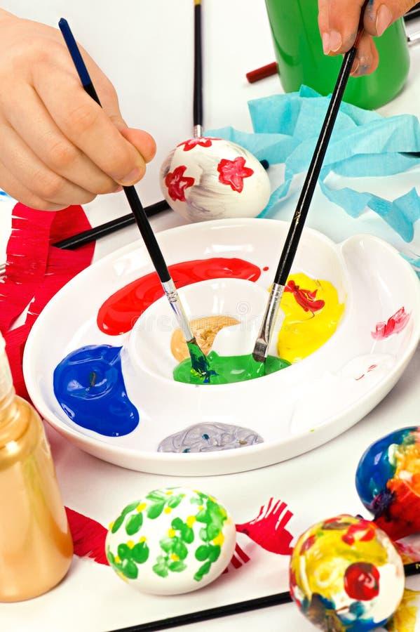 Escovas e pinturas foto de stock