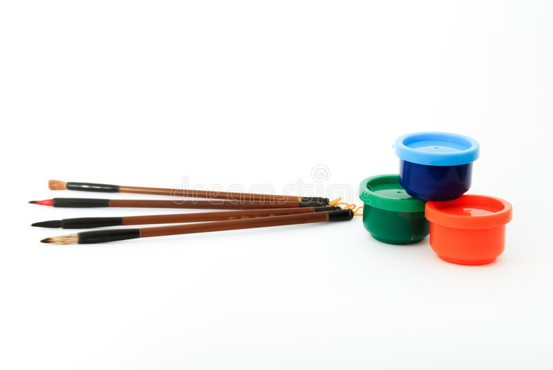 Escovas e pinturas imagem de stock