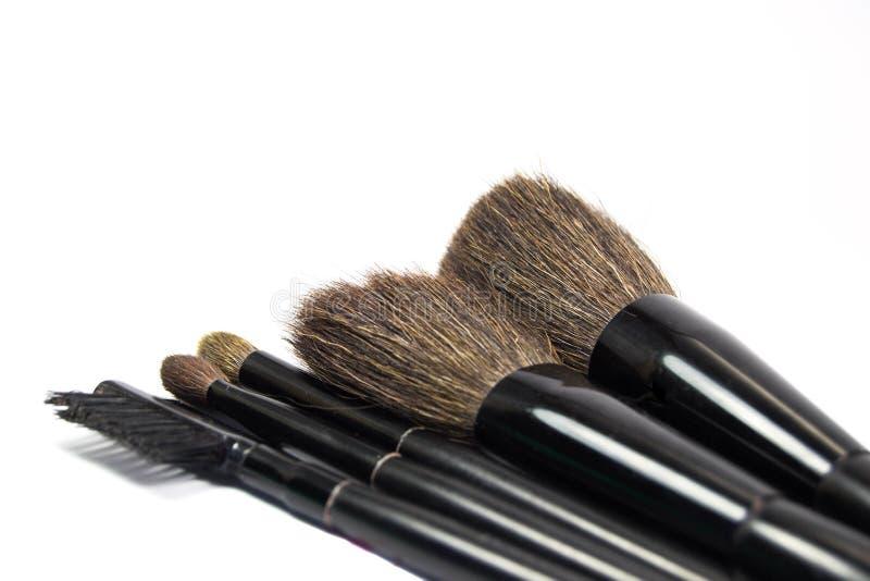 Escovas para a aplicação dos cosméticos fotografia de stock