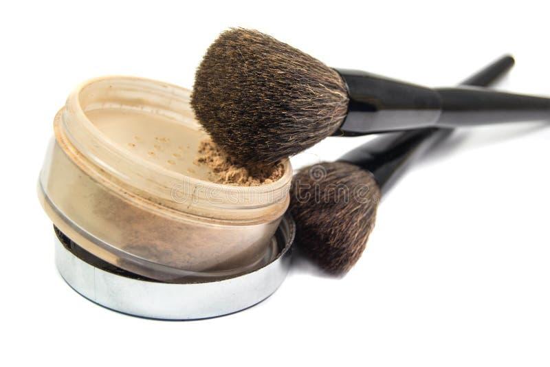 Escovas para a aplicação dos cosméticos e do pó imagem de stock