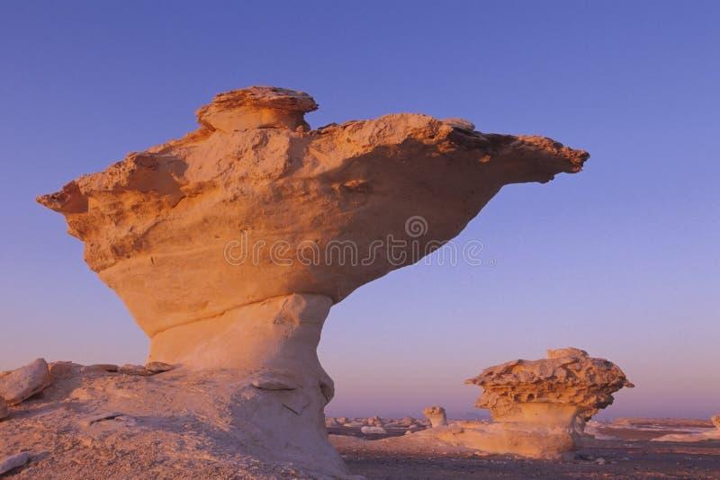 Escreva a rocha no nascer do sol fotografia de stock
