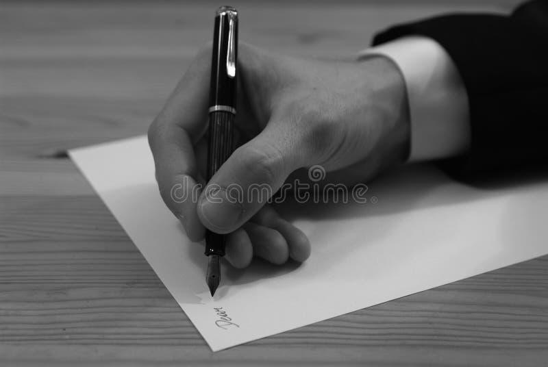 Escrevendo uma letra fotografia de stock royalty free