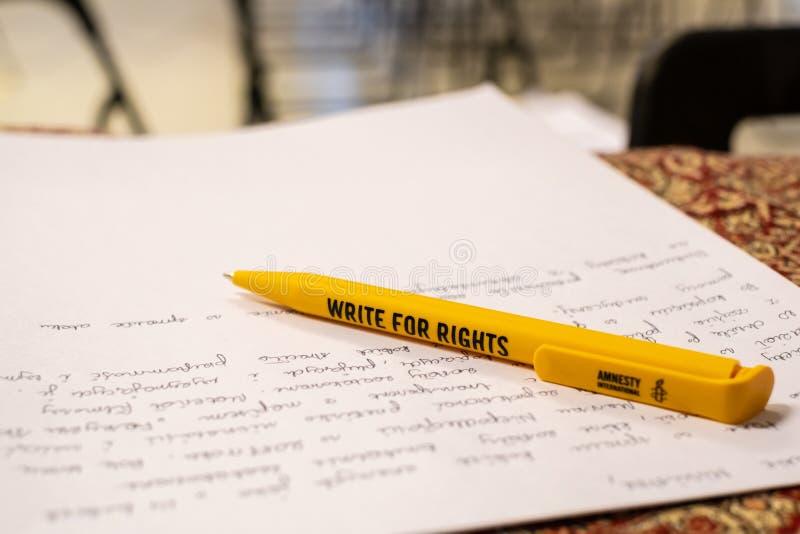 Escriba para las derechas, el acontecimiento más grande de los derechos humanos de Amnesty International foto de archivo