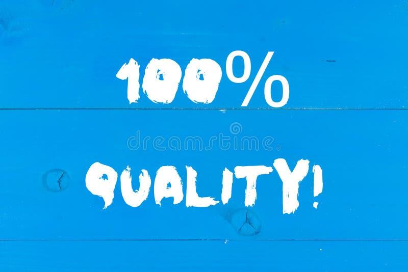 Escribiendo a demostración de la nota el 100 por ciento de calidad Foto del negocio que no muestra top garantizado de las sustanc fotografía de archivo libre de regalías