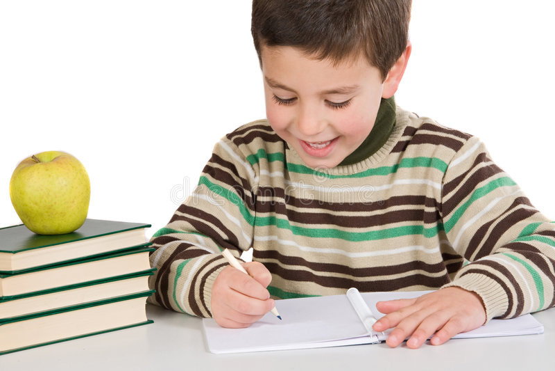 Escrita adorável da criança na escola foto de stock