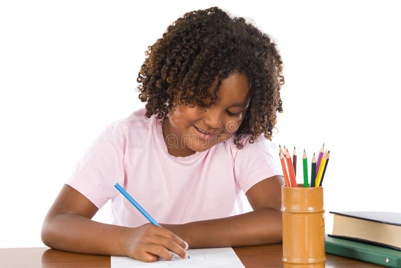Escrita africana adorável da menina fotografia de stock