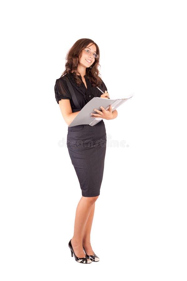 Escrita atrativa da mulher de negócios foto de stock