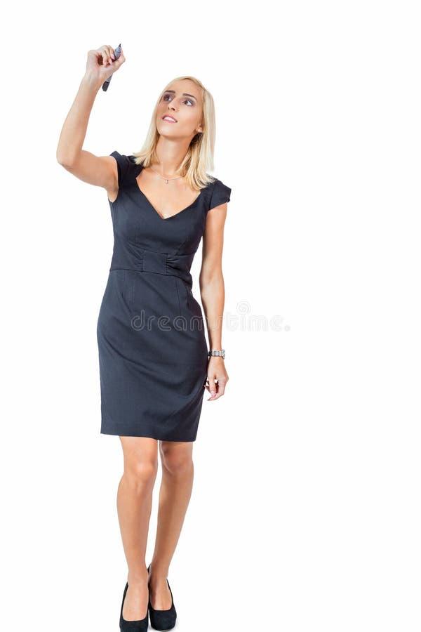 Escrita bem sucedida nova da mulher de negócio com a pena isolada imagem de stock