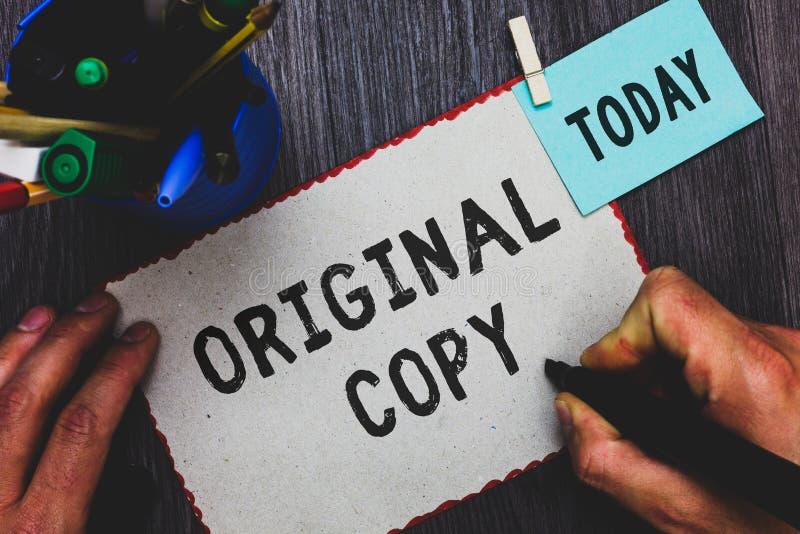 Escrita conceptual da mão que mostra a cópia original Terra arrendada patenteada marcada Unprinted do homem da lista principal do fotos de stock royalty free