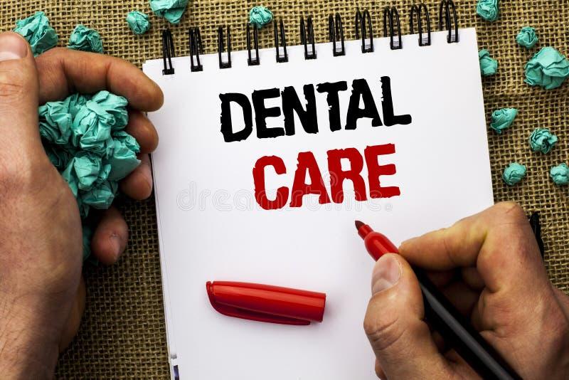 Escrita conceptual da mão que mostra cuidados dentários Da boca oral do dente do texto da foto do negócio wri de inquietação dos  imagens de stock royalty free